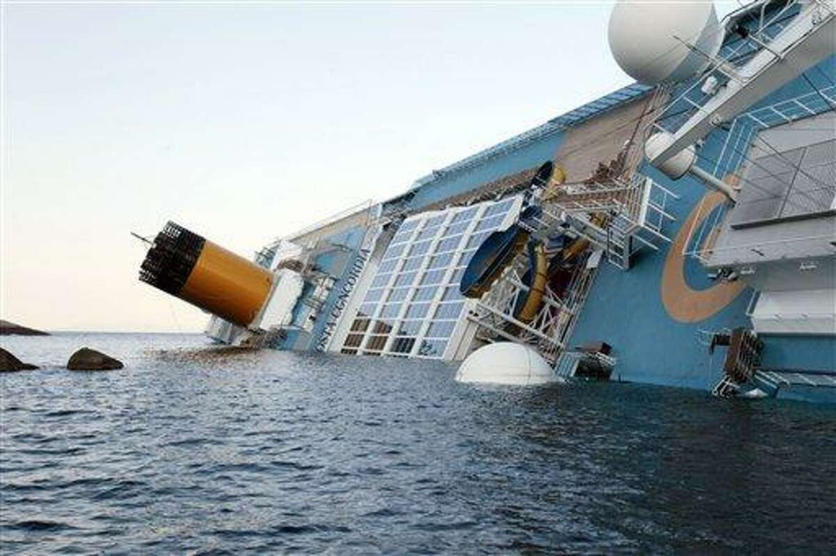 The luxury cruise ship Costa Concordia leans on its side after running aground off the tiny Tuscan island of Giglio, Italy, Saturday. Associated Press