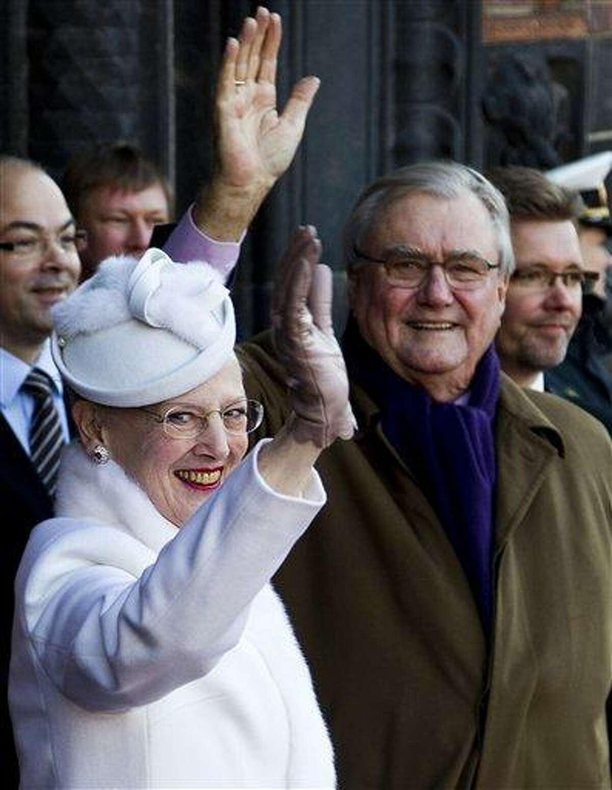 Danish Queen Margrethe and Prince Consort Henrik arrive at Copenhagen City Hall in Copenhagen Saturday. The Danish queen celebrates her 40th jubilee this weekend. Associated Press