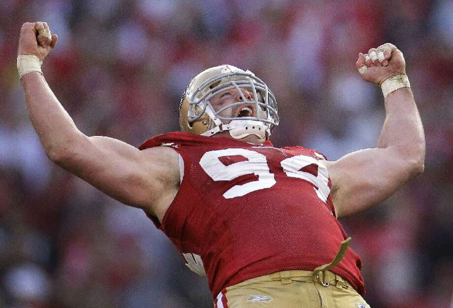 ASSOCIATED PRESS San Francisco 49ers defensive tackle Justin Smith (94) celebrates after sacking New Orleans Saints quarterback Drew Brees during the third quarter of Saturday's NFL divisional playoff game in San Francisco.