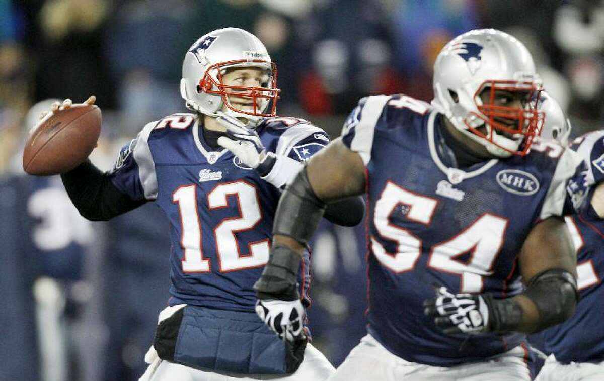 ASSOCIATED PRESS New England Patriots quarterback Tom Brady (12) reaches back to pass behind the blocking of guard Brian Waters (54) during the first half of an NFL divisional playoff game against the Denver Broncos Saturday in Foxborough, Mass. The Patriots won 45-10.