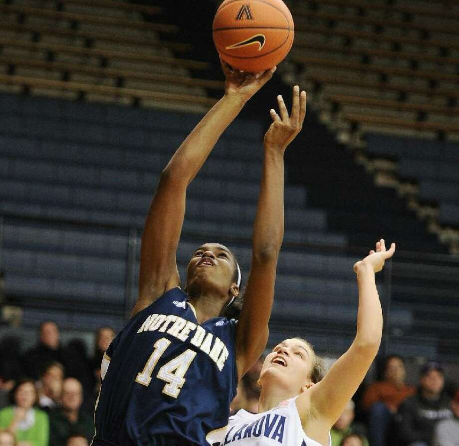 ASSOCIATED PRESS Notre Dame forward Devereaux Peters (14) shoots past Villanova guard Rachel Roberts (2) in the second half of a Jan. 29, 2011 game in Villanova, Pa. Roberts, a Marlborough native and former Mercy High standout, was excited to get a chance to face UConn Saturday. Roberts led the Wildcats with 16 points.
