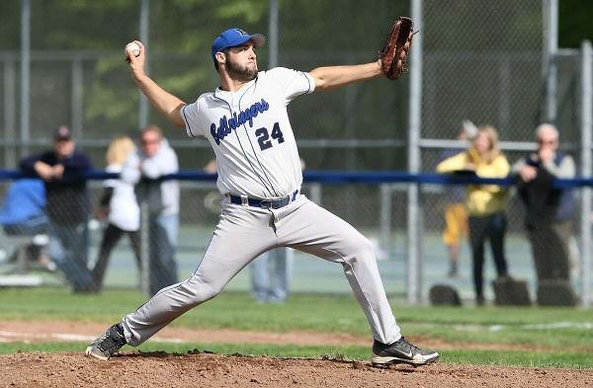 Special to the Press 05.11.12. East HamptonÕs Spencer Daly heads for third on Joe TuxburyÕs one-out single in FridayÕs game with Haddam-Killingworth. East Hampton won, 1-0. To buy a glossy print of this photo and more, visit www.middletownpress.com