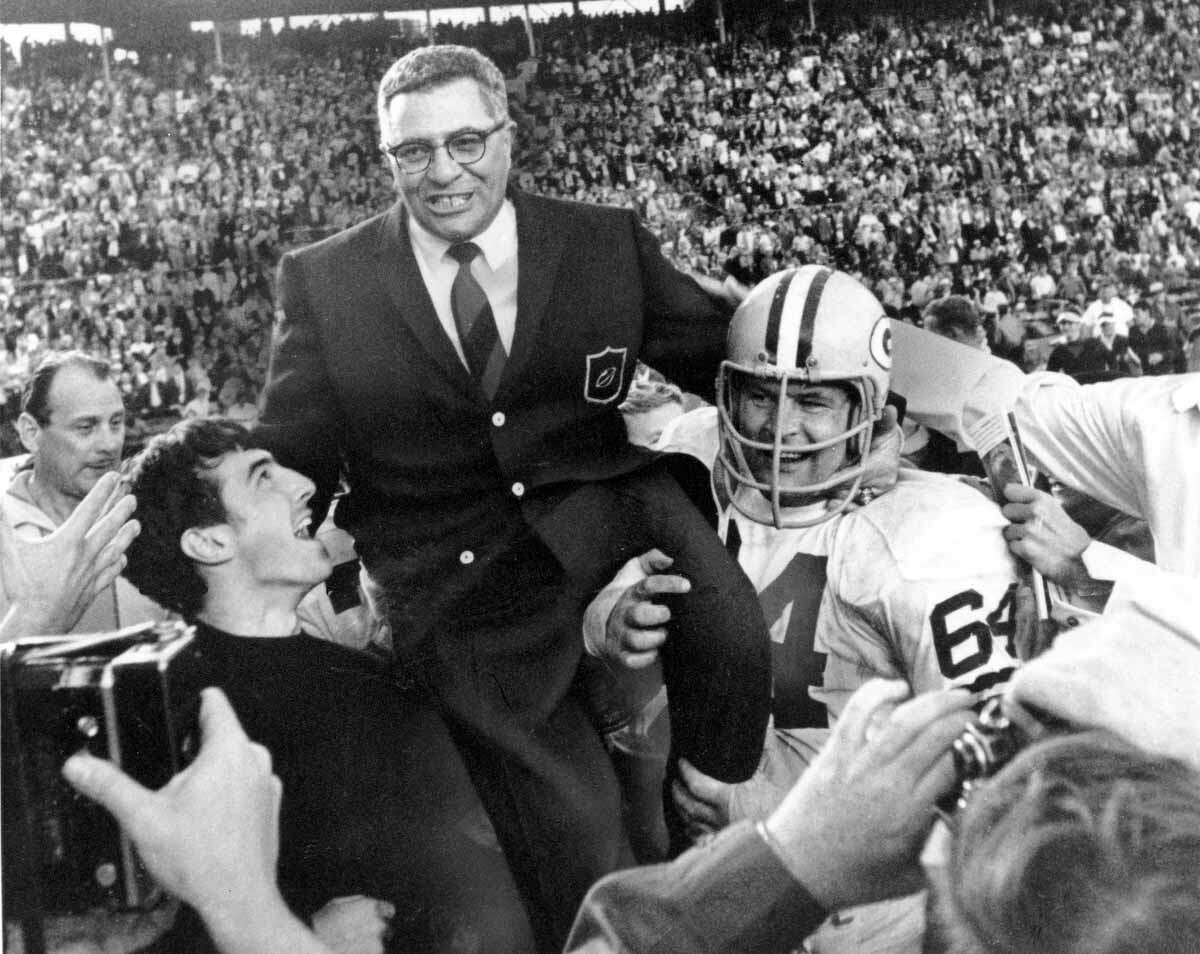 Green Bay Packers coach Vince Lombardi is carried off the field after his team defeated the Oakland Raiders 33 to 14 in the Super Bowl II game in Miami, Fla. on Jan. 14, 1968. Packers guard Jerry Kramer (64) is at right. (AP Photo)