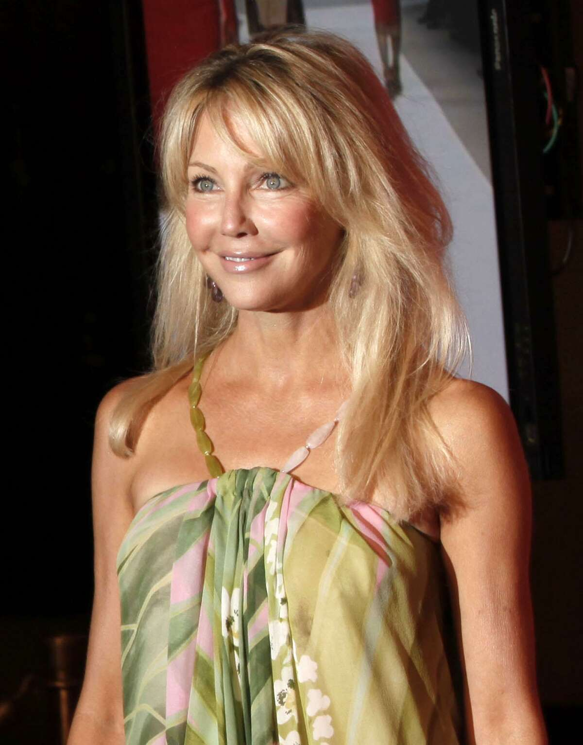 In this 2009 file photo, Heather Locklear arrives at the Women in Film Crystal Lucy Awards in Los Angeles. Paramedics responded to Locklear's home 35 miles northwest of Los Angeles for a medical emergency and transported a woman matching the actress' description as a precautionary measure, authorities said Thursday. (Associated Press, file)