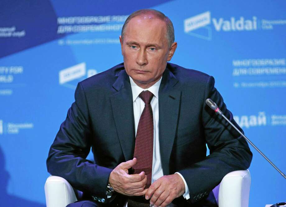 Russian President Vladimir Putin listens to a question during the final plenary meeting of the Valdai International Discussion Club in the Novgorod Region, on the banks of Lake Valdai, Russia, Thursday, Sept. 19, 2013. President Vladimir Putin says that Russia has strong grounds to believe that Syrian rebels were responsible for the country's chemical attack. (AP Photo/Alexander Zemlianichenko, pool) Photo: AP / AP POOL