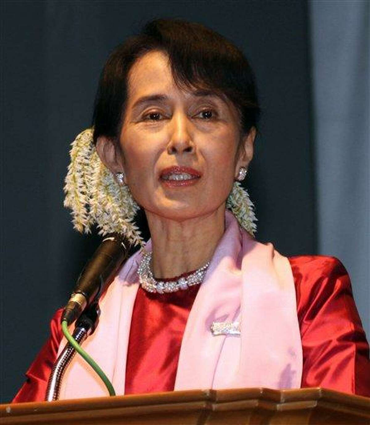 In this Jan. 4, 2012, file photo, Myanmar's pro-democracy leader Aung San Suu Kyi delivers her speech during a short films festival in Yangon, Myanmar. French President Nicolas Sarkozy's office says he has decided to give France's highest award, the Legion of Honor, to her. Associated Press