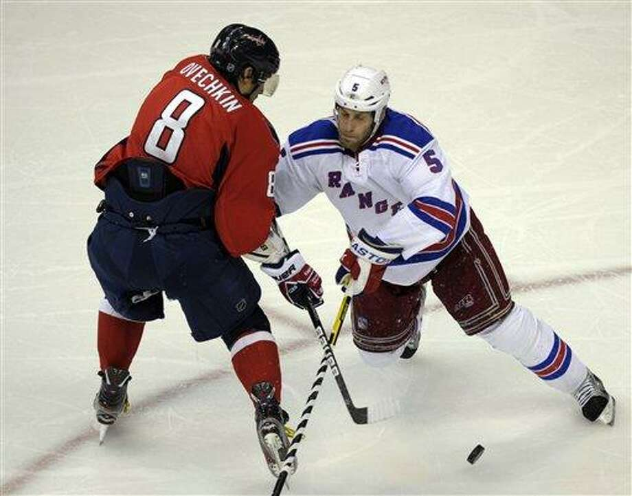 Washington Capitals left wing Alex Ovechkin (8) battles with New York Rangers defenseman Dan Girardi (5) in the second period of Game 6 of a second-round NHL hockey Stanley Cup playoff series in Washington, Wednesday, May 9, 2012. (AP Photo/Susan Walsh) Photo: ASSOCIATED PRESS / AP2012