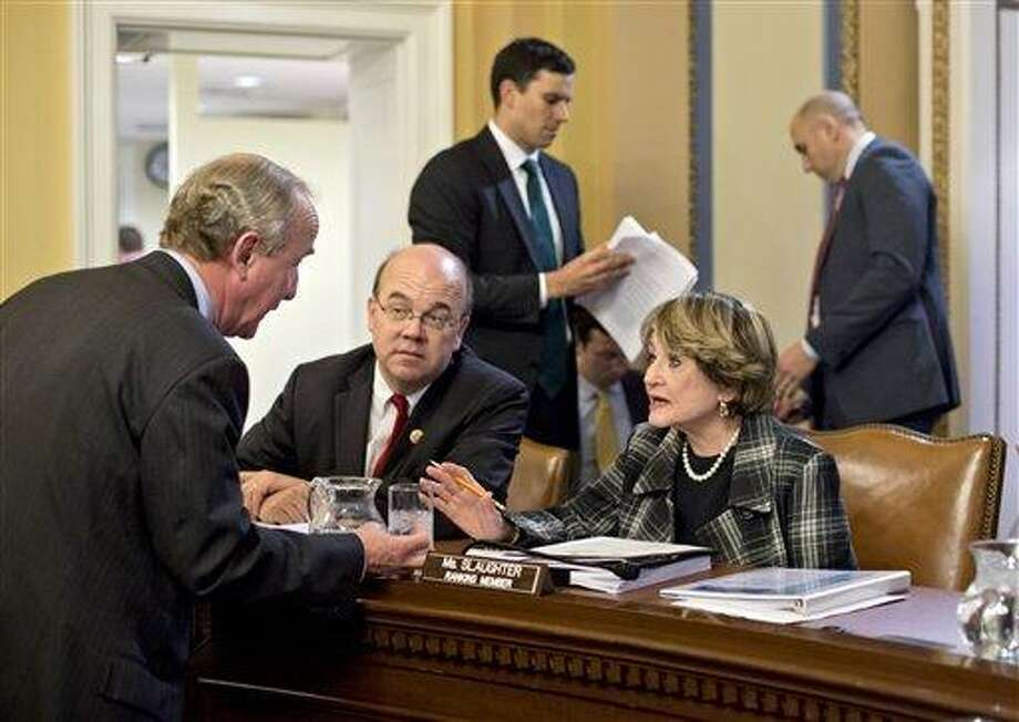 Rep. Rodney Frelinghuysen, R-N.J., left, confers with Rep. Louise Slaughter, D-N.Y., Rep. Jim McGovern, D-Mass., center, as the House Rules Committee sorts through dozens of amendments on an aid package to assist victims of Superstorm Sandy that devastated parts of the Northeast coast in October, at the Capitol in Washington, Monday, Jan. 14, 2013. The House is expected to vote on the bill Tuesday. (AP Photo/J. Scott Applewhite) Photo: AP / AP