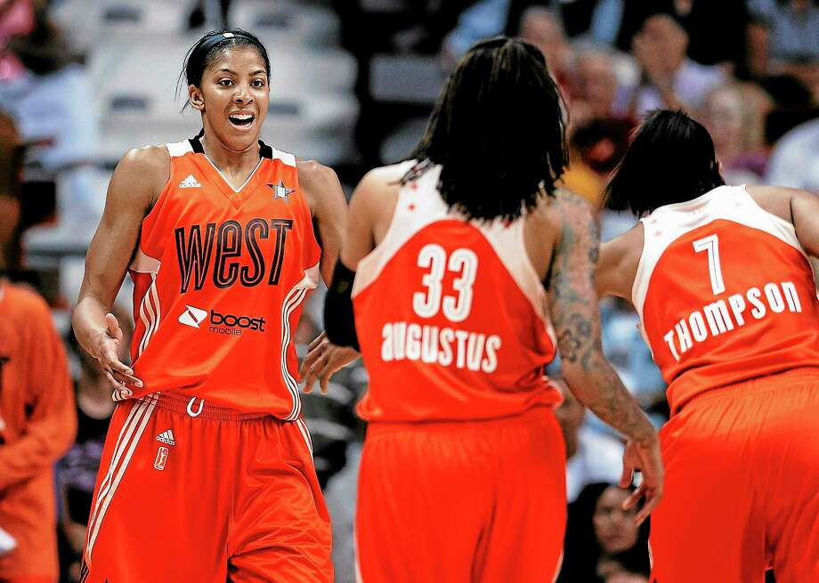 The Los Angeles Sparks' Candace Parker, left, at the 2013 WNBA All-Star Game in Uncasville, has been named MVP, according to a source. Photo: Jessica Hill — The Associated Press  / AP2013