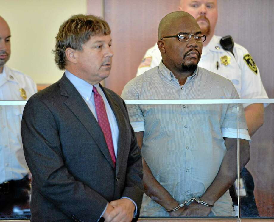 Ernest Wallace of Bristol, right, an associate of former New England Patriots star Aaron Hernandez, stands beside his attorney, David Meier, during his arraignment Thursday in Superior Court in Fall River, Mass. Wallace pleaded not guilty to an accessory to murder charge in connection with the death of Odin Lloyd, 27, whose body was found in North Attleborough, Mass., about a mile from Hernandez's home. Photo: Josh Reynolds — The Associated Press  / FR25426 AP POOL
