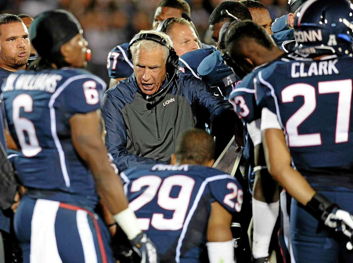 UConn head coach Paul Pasqualoni instructs his team on the sideline during the second half of the Huskies' loss to Maryland Saturday at Rentschler Field in East Hartford.