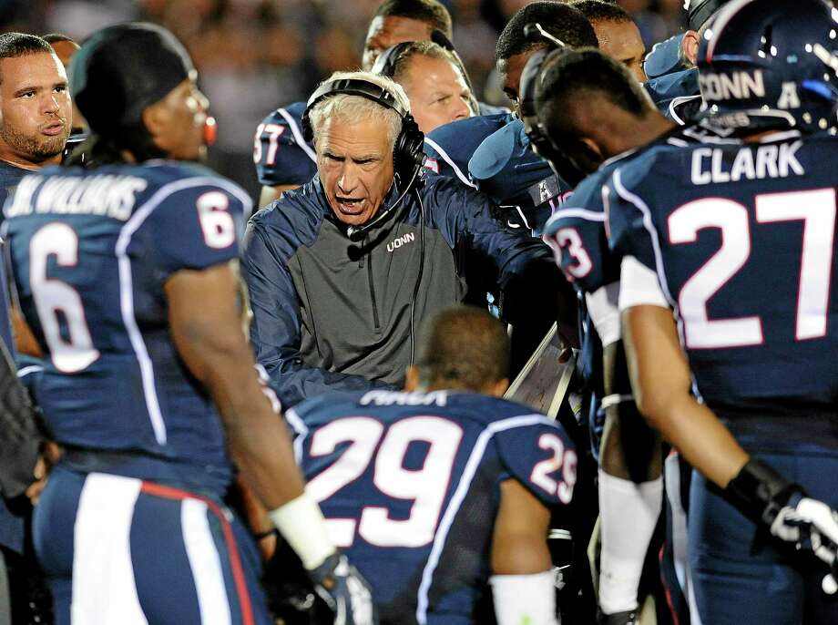 UConn head coach Paul Pasqualoni instructs his team on the sideline during the second half of the Huskies' loss to Maryland Saturday at Rentschler Field in East Hartford. Photo: Jessica Hill — The Associated Press  / AP2013