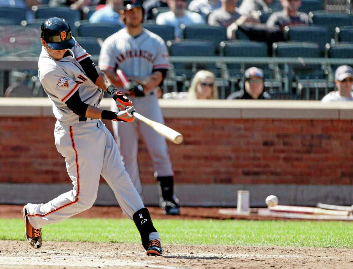 The Giants' Ehire Adrianza connects to drive in a run during the fourth inning of San Francisco's 2-1 win over the Mets on Thursday afternoon at Citi Field in New York.