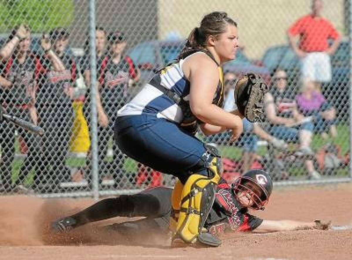 Mercy senior catcher Tyler Keegan waits for the throw as Cheshire's Olivia Odermatt slides in at home Friday afternoon in Middletown. The Rams defeated the Tigers 7-4 ending Mercy's 14-game winning streak. Photo by Catherine Avalone/The Middletown Press