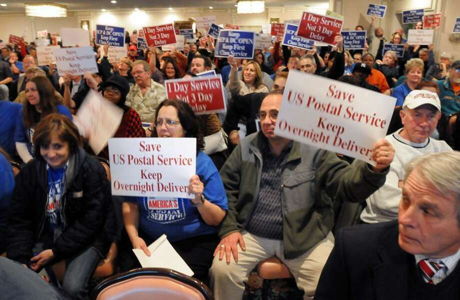 About 400 people, mostly postal workers, came out to a presentation made by the USPS about closing the Southern Connecticut Distribution and Processing Center in Wallingford. Mara Lavitt/Register