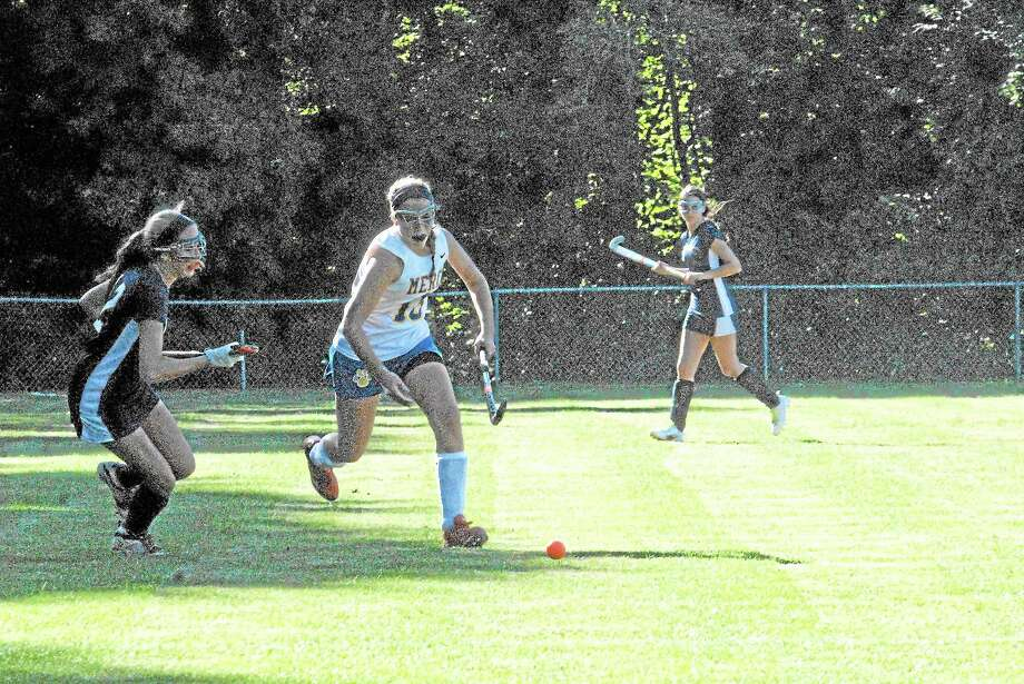Jimmy Zanor — The Middletown Press Mercy's Madison Derita moves the ball up the field as Lyman Hall's Ashley Lane defends. Photo: Journal Register Co.