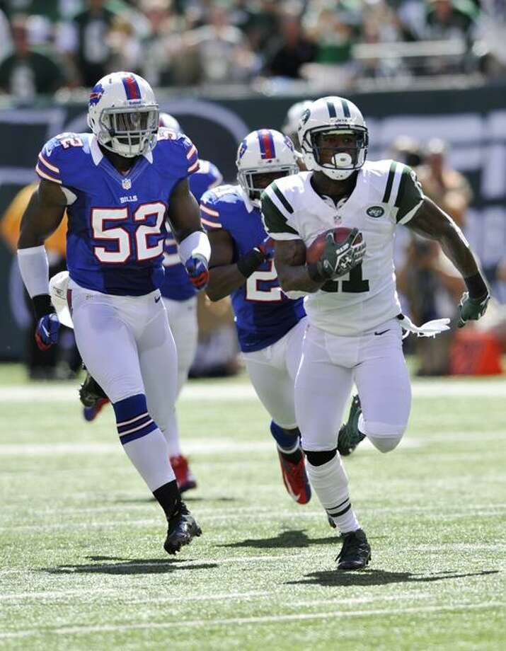 New York Jets  Jeremy Kerley (11) returns a punt for a touchdown while chased bt Buffalo Bills linebacker Arthur Moats (52)during the first half of an NFL football game at MetLife Stadium, Sunday, Sept. 9, 2012, in East Rutherford, N.J. (AP Photo/Bill Kostroun) Photo: AP / AP2012