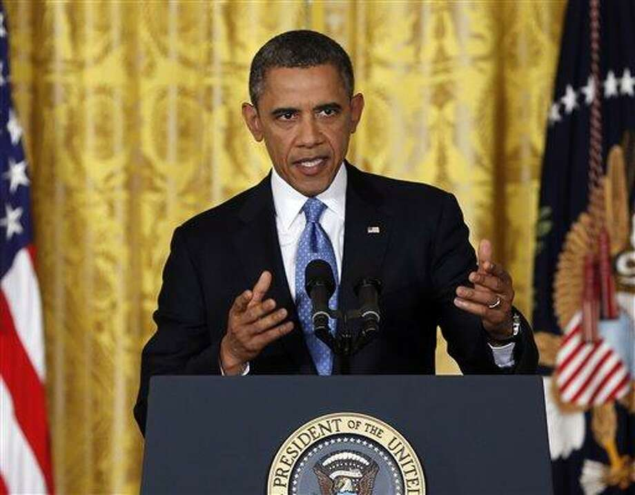 President Barack Obama speaks about the debt limit in the East Room of the White House in Washington, Monday. AP Photo/Carolyn Kaster Photo: AP / AP