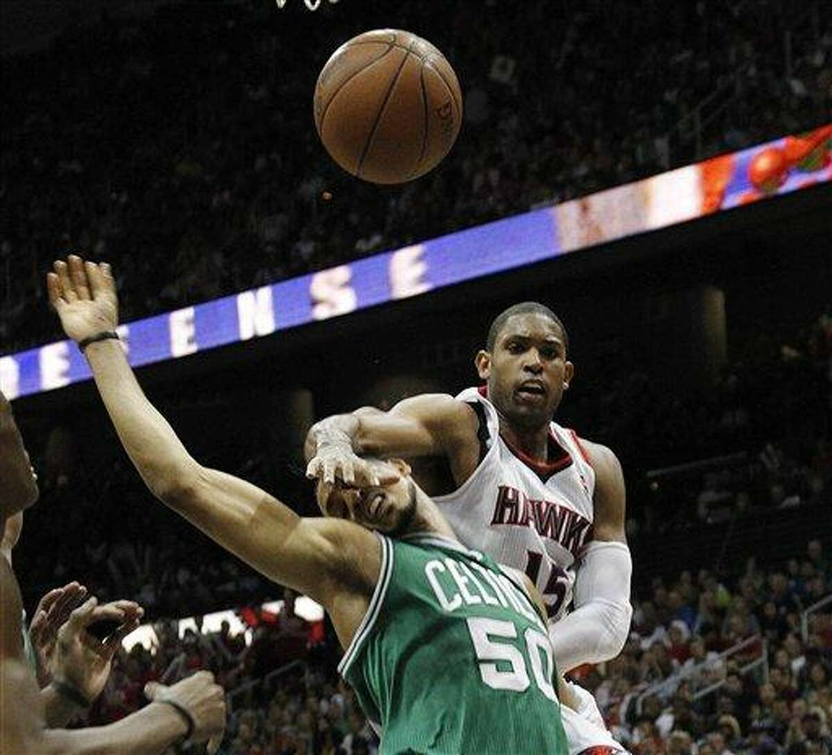 Atlanta Hawks center Al Horford (15) and Boston Celtics center Ryan Hollins (50) battle for a loose ball during the second half of Game 5 of an NBA first-round playoff series basketball game Tuesday, May 8, 2012, in Atlanta. Atlanta won 87-86. (AP Photo/John Bazemore)