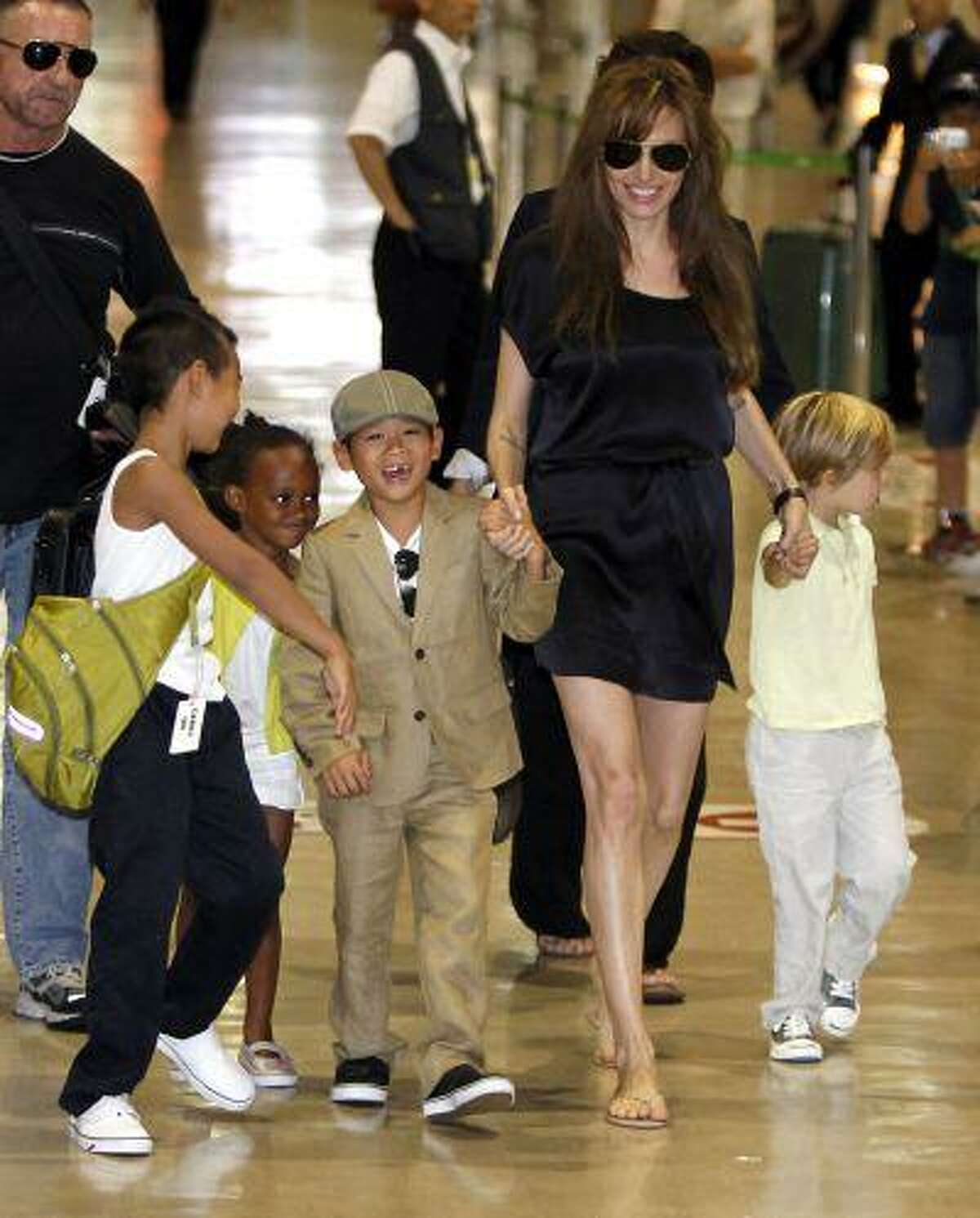 U.S. actress Angelina Jolie (2nd R) arrives with her children Maddox, Zahara, Pax Thien and Shiloh (L-R) at New Tokyo International Airport in Narita, east of Tokyo, in this July 26, 2010 file photo. Oscar-winning actress Jolie said on May 14, 2013 that she had undergone a preventive double mastectomy after finding out she had a gene mutation that leads to a sharply higher risk of both breast and ovarian cancer.
