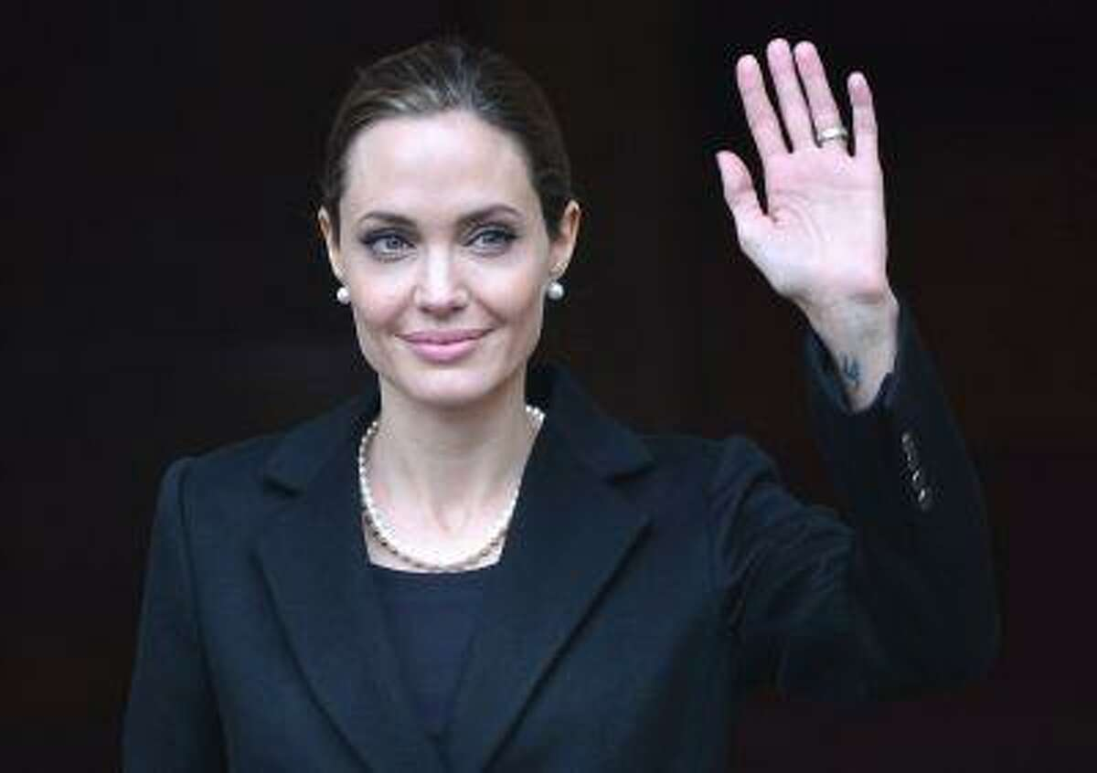U.S. actress and humanitarian campaigner Angelina Jolie leaves a G8 Foreign Ministers Meeting in London in this April 11, 2013 file photo.