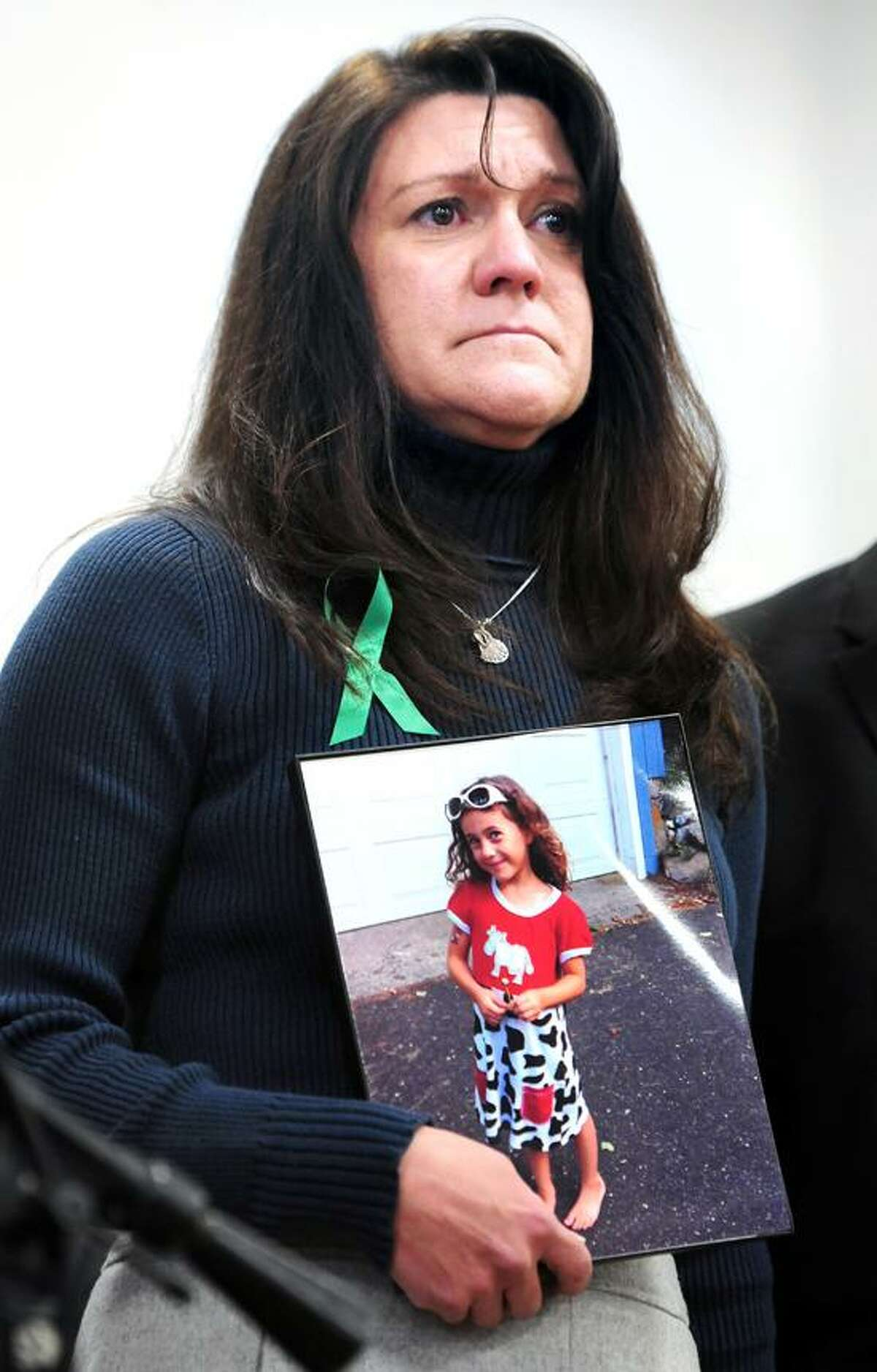 Jennifer Hensel holds a photograph of her daughter, Avielle, at a press conference announcing the launch of Sandy Hook Promise at Edmond Town Hall in Newtown on 1/14/2013. Photo by Arnold Gold/New Haven Register