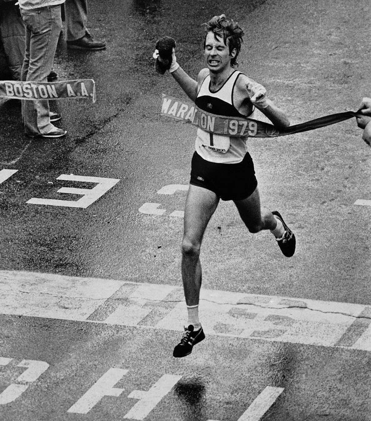 Bill Rodgers of Melrose, Mass., breaks the tape as he crosses the finish line in Boston, April 17, 1979, to win the 83rd running of the Boston Marathon in 2 hours, 9 minutes, 27 seconds. (AP Photo)
