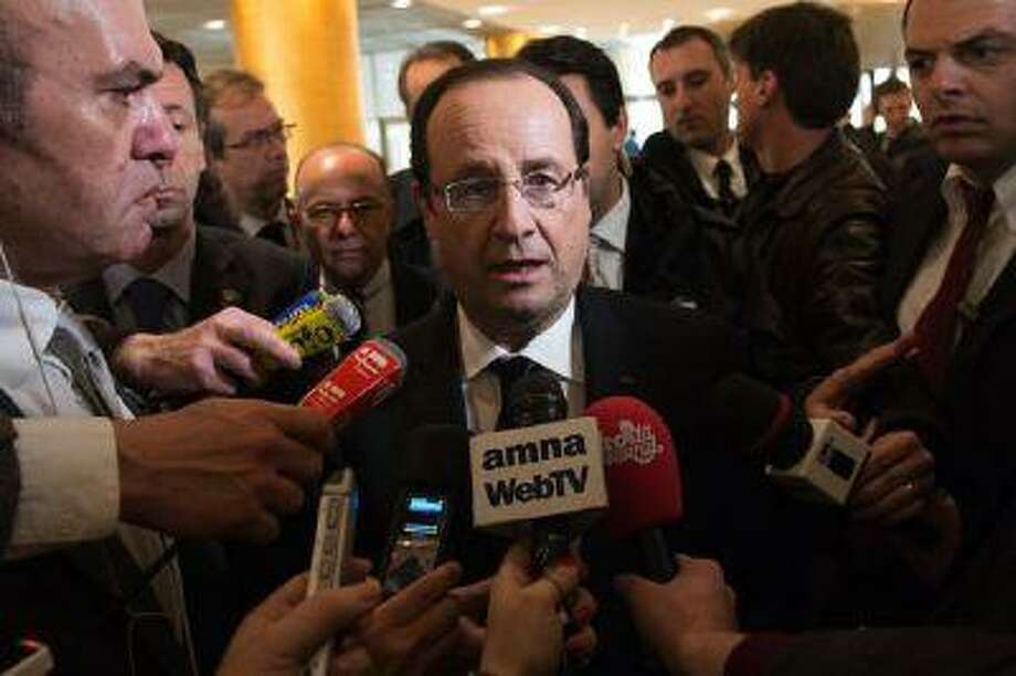 France entered a recession Wednesday after a drop in growth for two consecutive quarters. In this picture, France's President Francois Hollande arrives in Athens on Feb. 19.