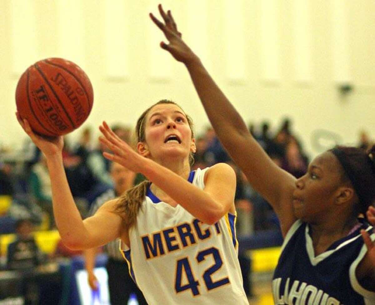 Special to the Press 01.12.12 Mercy's Sheena Landy looks for an opening in the Hillhouse defense in Thursday's game. Hillhouse won, 56-55.To buy a glossy print of this photo and more, visit www.middletownpress.com.