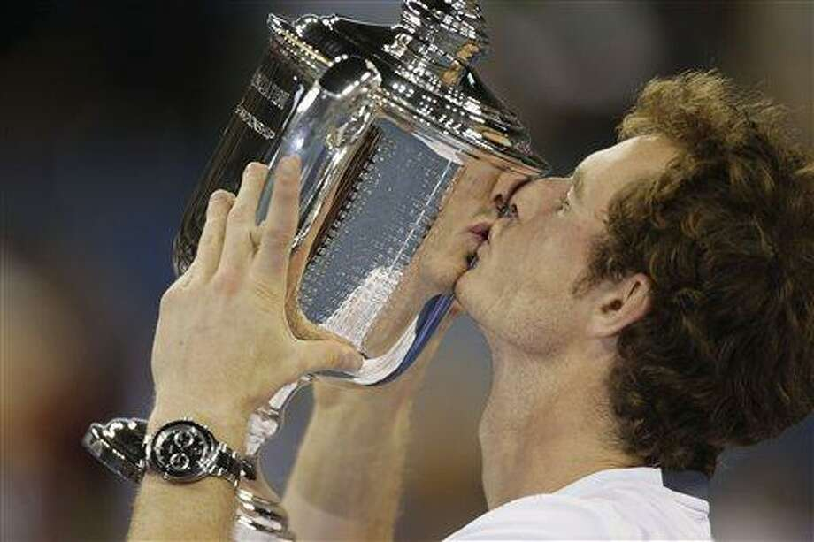 Britain's Andy Murray poses with the trophy after beating Serbia's Novak Djokovic in the championship match at the 2012 US Open tennis tournament,  Monday, Sept. 10, 2012, in New York. Murray vs. Djokovic was a test of will as much as skill, lasting 4 hours, 54 minutes, tying the record for longest U.S. Open final. (AP Photo/Charles Krupa) Photo: ASSOCIATED PRESS / AP2012