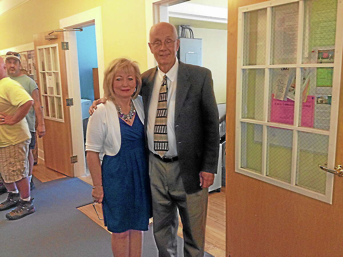 Antoinette Astle, left, is pictured with Middlefield First Selectman Jon Brayshaw at a retirement ceremony held in Astle's honor Thursday.