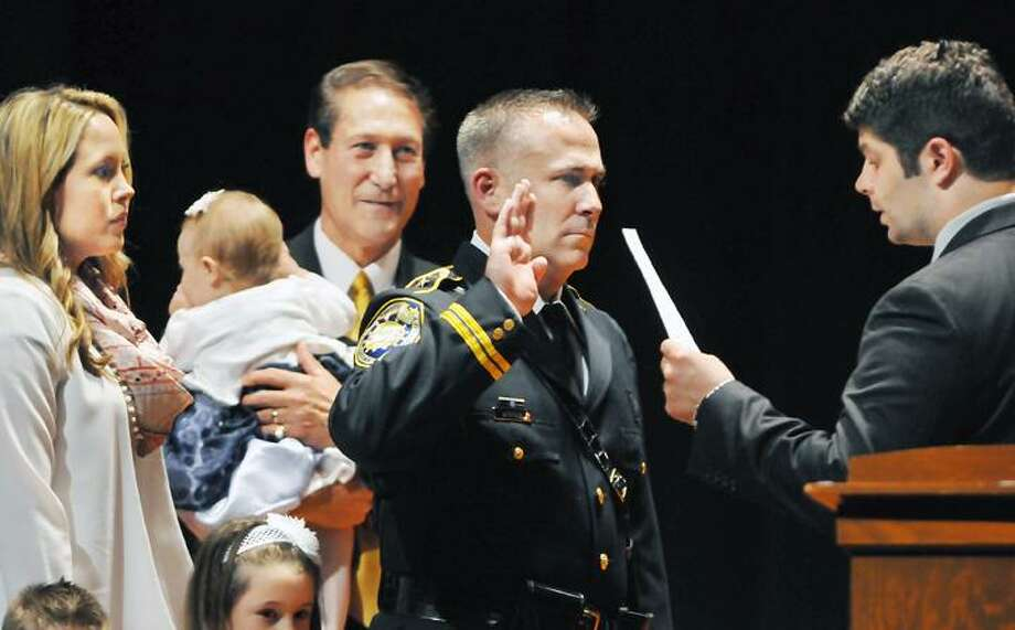 @CAvaloneMP  5.9.12 Mayor Daniel Drew swears in William Nicholas McKenna as Police Chief of the city of Middletown Wednesday evening at Mercy High School. Also pictured is Councilman Tom Serra, majority leader holds 10 month old Katie-Faith McKenna. / TheMiddletownPress