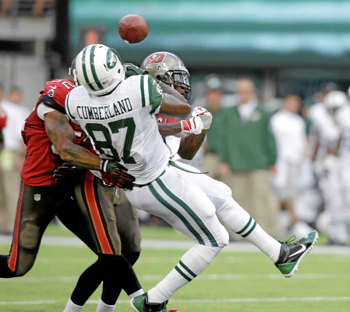 Jets tight end Jeff Cumberland (87) gets the ball knocked out by a hit from Tampa Bay Buccaneers free safety Dashon Goldson, right, and outside linebacker Jonathan Casillas during a Sept. 8 game in East Rutherford, N.J. The Buccaneers were penalized for an unnecessary roughness call on the play.