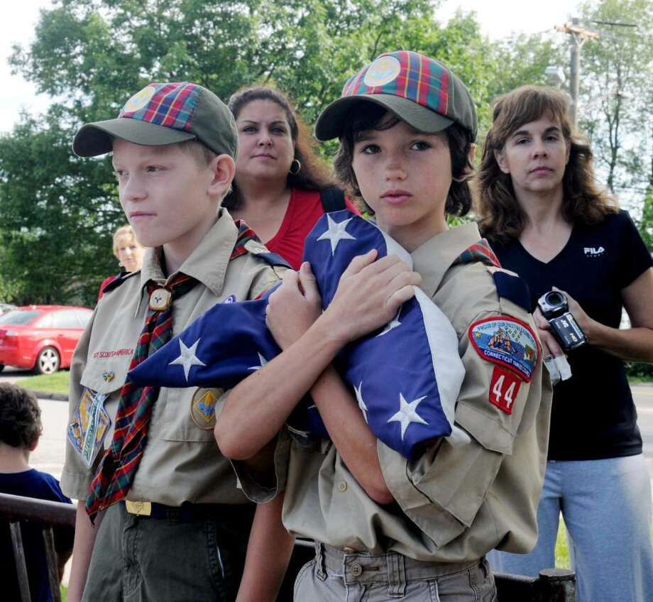 Boy Scouts Misha Prukalski, 9, left and Justin Holt, 9, both of Danbury helped in taking down the retired flag during Stadley Rough Elementary School's Flag Day ceremony on Tuesday June 15, 2010. Photo: Lisa Weir / The News-Times Freelance