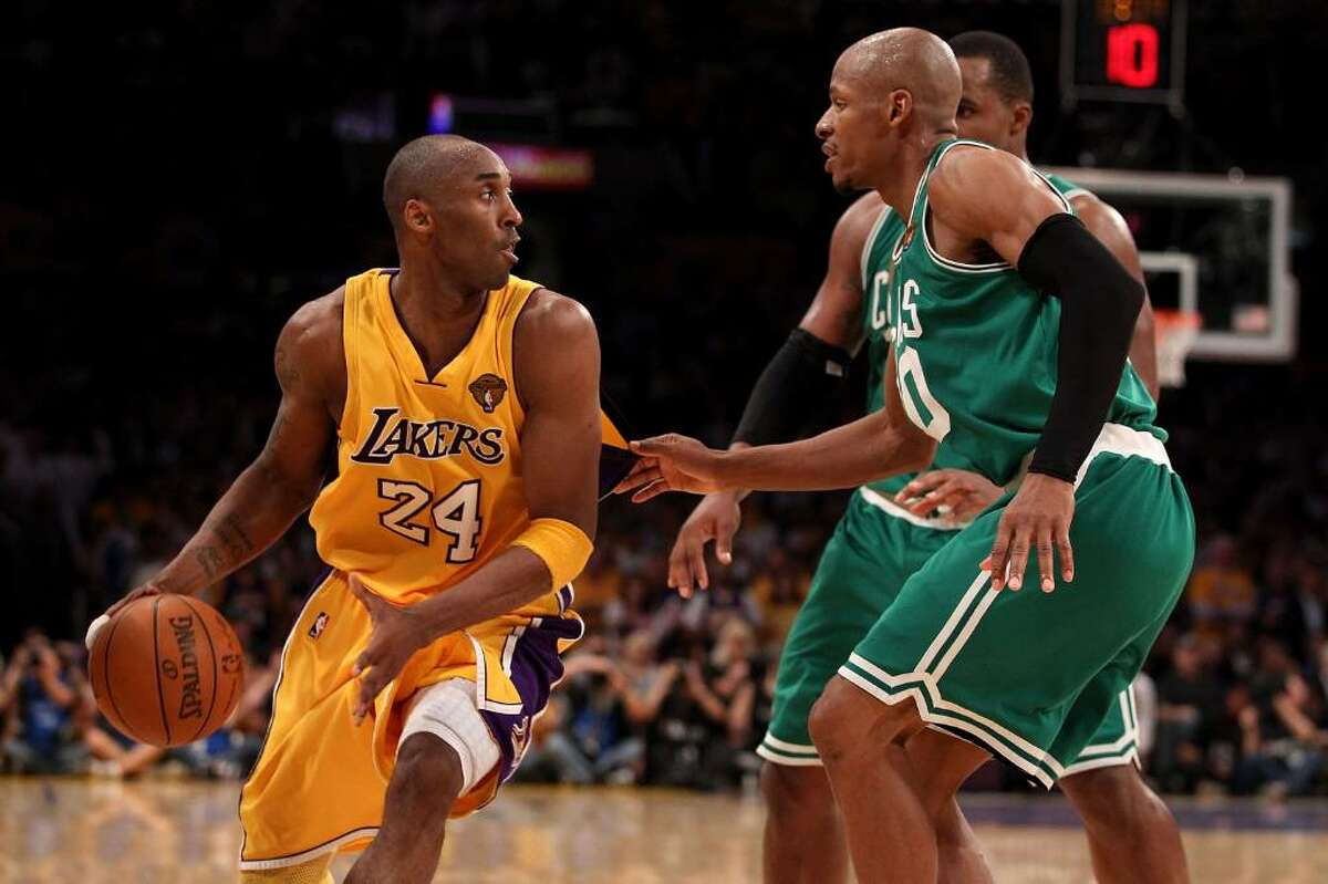 LOS ANGELES, CA - JUNE 17: Kobe Bryant #24 of the Los Angeles Lakers moves the ball against Ray Allen #20 and Glen Davis #11 of the Boston Celtics in Game Seven of the 2010 NBA Finals at Staples Center on June 17, 2010 in Los Angeles, California. NOTE TO USER: User expressly acknowledges and agrees that, by downloading and/or using this Photograph, user is consenting to the terms and conditions of the Getty Images License Agreement. (Photo by Christian Petersen/Getty Images) *** Local Caption *** Kobe Bryant;Ray Allen;Glen Davis