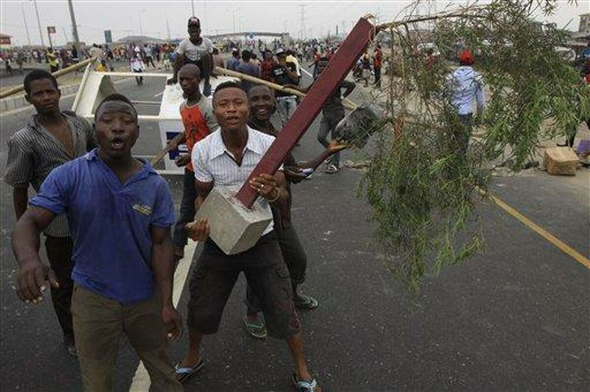Angry youths protest on a Lekki road during third day of nationwide strike over the removal of fuel oil subsidies. Associated Press