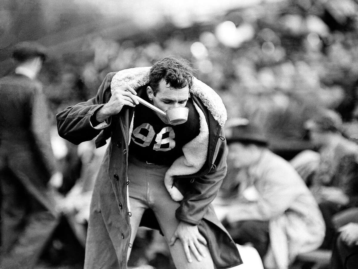 """""""Tornado Tom"""" Harmon, Michigan's sensational halfback, takes a drink of water during Michigan 85-0 win at Chicago on Oct. 21, 1939."""