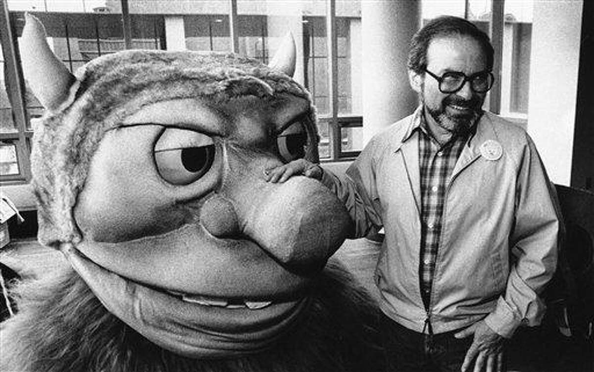 In this 1985 file photo, Sendak poses with one of the characters from his book