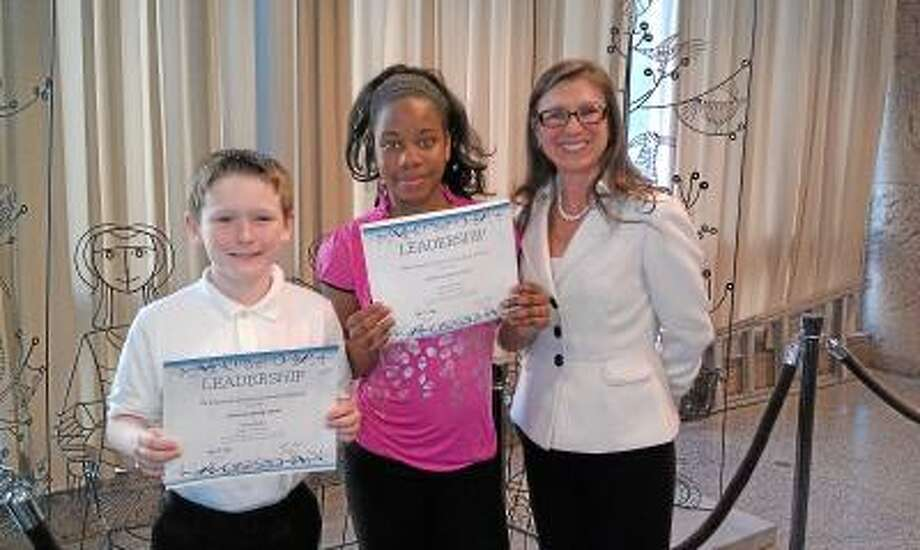 Submitted photo Ethan Barker and Syleena Daniels of Keigwin Middle School received the sixth-grade CABE leadership awards and are seen here with Principal Sylvia Mayo Molina.