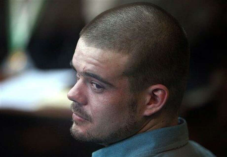 Joran van der Sloot looks back from his seat after entering the courtroom for the continuation of his murder trial at San Pedro prison in Lima, Peru, Wednesday. Associated Press Photo: ASSOCIATED PRESS / AP2012