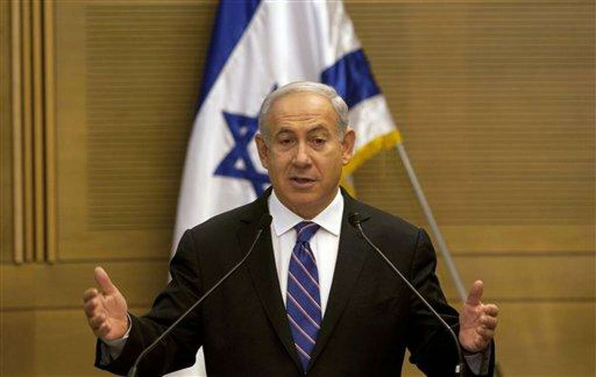 Israel's Prime Minister Benjamin Netanyahu gestures during a joint press conference with Kadima party leader Shaul Mofaz, unseen, announcing the new coalition government in Jerusalem Tuesday. Associated Press