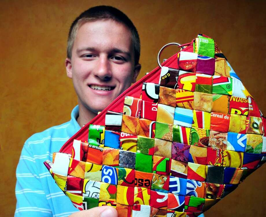 Charlie Proctor, 17, of Durham and founder of the Honduras Children's Project is photographed on 8/30/2012n with an eco-friendly trashy clutch handbag which is woven from strips of plastic bag trash by women in Villa Soleada, Honduras.  The project benefits the children of Copprome Orphanage.Photo by Arnold Gold/New Haven Register   AG0461A