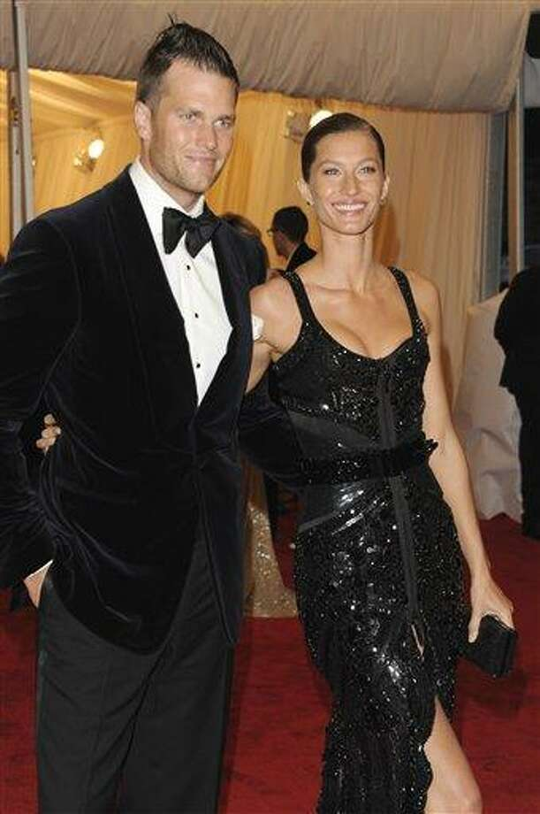 Tom Brady and Gisele Bundchen arrives Monday at the Metropolitan Museum of Art Costume Institute gala benefit, celebrating Elsa Schiaparelli and Miuccia Prada in New York. Associated Press Photo: AP / AGOEV