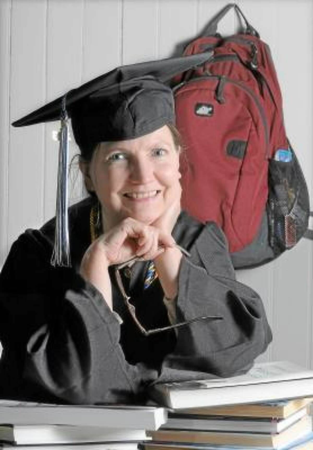 Catherine Avalone/The Middletown Press Middletown resident Karen Johnson, 54 will graduate from Central Connecticut State University Saturday with a degree in geography.