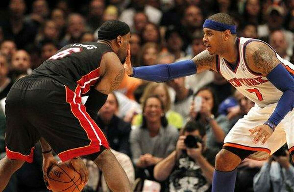 Miam Heat's LeBron James feels Knicks' Carmelo Anthony's hand in his face in the fourth quarter of Game 4 of an NBA basketball first-round playoff series at Madison Square Garden, Sunday, May 6, 2012, in New York. (AP Photo/Miami Herald, Charles Trainor Jr.) MAGS OUT