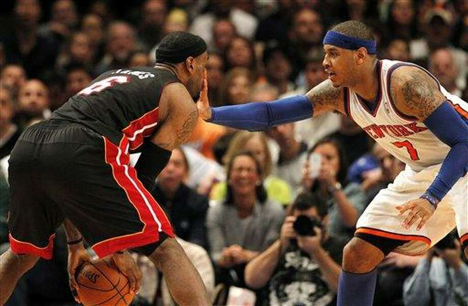 Miam Heat's LeBron James feels Knicks' Carmelo Anthony's hand in his face in the fourth quarter of Game 4 of an NBA basketball first-round playoff series at Madison Square Garden, Sunday, May 6, 2012, in New York. (AP Photo/Miami Herald, Charles Trainor Jr.) MAGS OUT Photo: AP / Miami Herald