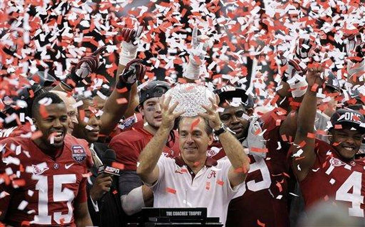 Alabama head coach Nick Saban celebrates with his team after the BCS National Championship college football game against LSU Monday, Jan. 9, 2012, in New Orleans. Alabama won 21-0. (AP Photo/Gerald Herbert)