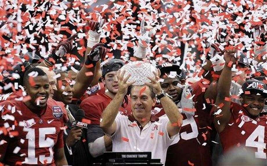 Alabama head coach Nick Saban celebrates with his team after the BCS National Championship college football game against LSU Monday, Jan. 9, 2012, in New Orleans. Alabama won 21-0. (AP Photo/Gerald Herbert) Photo: AP / AP