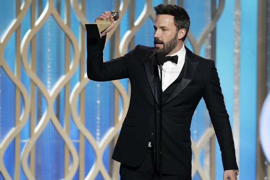 "This image released by NBC shows Ben Affleck with his award for best director for ""Argo"" during the 70th Annual Golden Globe Awards at the Beverly Hilton Hotel on Jan. 13, 2013, in Beverly Hills, Calif. (AP Photo/NBC, Paul Drinkwater) Photo: AP / NBCUniversal Media2013"