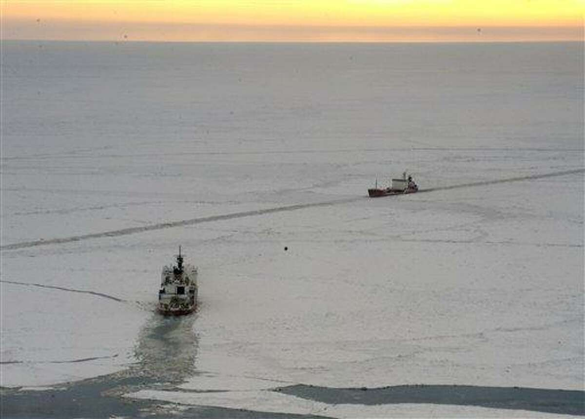 In this Jan. 7 photo provided by the U.S. Coast Guard, the Coast Guard Cutter Healy crew steers their ship along side the tanker Renda as they conduct a return cut through the ice in the bearing Sea near Nome, Alaska. Shifting ice in the Bering Sea that at times is pinching the sides of the Russian tanker is raising the specter that a mission to deliver fuel to an iced-in Alaska community might not be possible. Associated Press